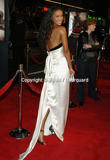 Joy Bryant arriving at the GET RICH OR DIE TRYING Premiere at the Chinese Theatre in Los Angeles. November 2, 2005.<br /> <br /> over the shoulder<br /> back of the dress<br /> skin<br /> naked back<br /> shoulder naked