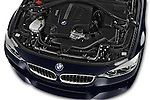 Car Stock 2015 BMW 4 Series 435i Gran Coupe 5 Door Hatchback Engine  high angle detail view