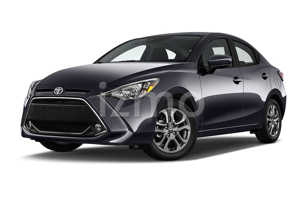 Stock pictures of low aggressive front three quarter view of a 2018 Toyota Yaris LE 4 Door Sedan