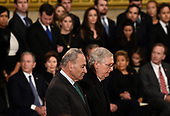US Senator Mitch McConnell (R-KY) (R) and  US Senate Minority Leader Chuck Schumer (D-NY) pay their respects during the service for former US President George H.W. Bush as he lies in state at the US Capitol during a State Funeral in Washington, DC, December 3, 2018. - The body of the late former President George H.W. Bush will travel from Houston to Washington, where he will lie in state at the US Capitol through Wednesday morning. Bush, who died on November 30, will return to Houston for his funeral on Thursday. (Photo by Brendan SMIALOWSKI / AFP)