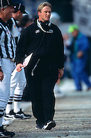 OAKLAND, CA - Head coach Jon Gruden of the Oakland Raiders watches the action during a game against the New York Jets at the Oakland Coliseum in Oakland, California in 2002. Photo by Brad Mangin