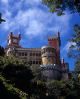 View looking up to the Palacio de Pena, Sintra with its towers and turrets and mix of architectural styles