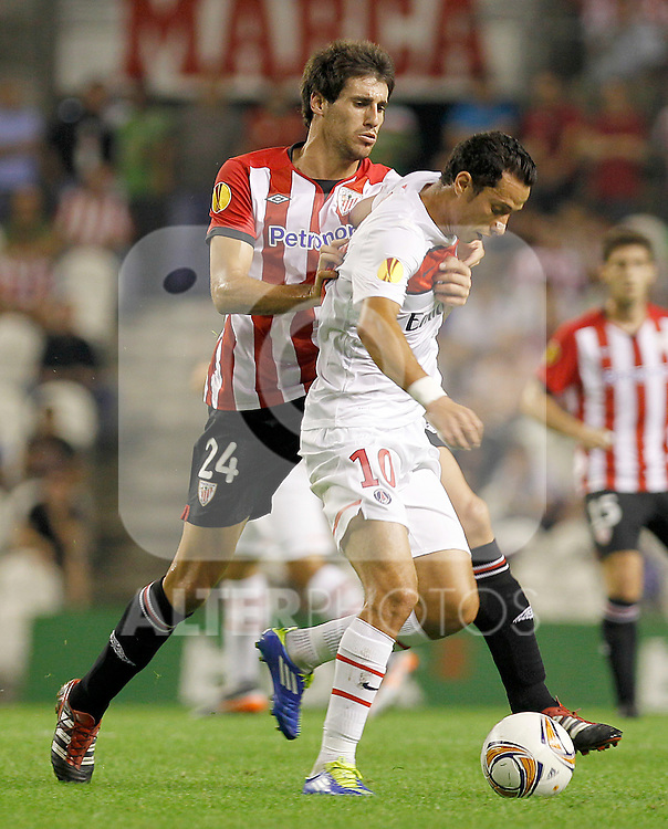 Athletic de Bilbao's Javi Martinez (l) and Paris Saint-Germain's Nene (r) during Europa League match.September 29,2011. (ALTERPHOTOS/Acero)