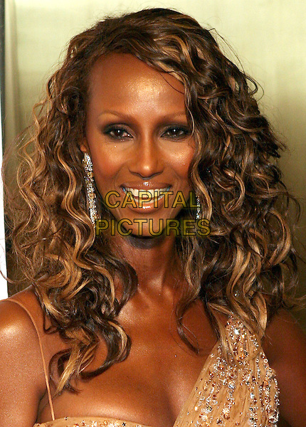 IMAN.2005 Fashion Rocks held at the Radio City Music Hall.New York.USA, United States.8th September 2005.Ref: ADM/JL.portrait headshot gold bronze fitted sequin sequinned off the shoulder curls curly ringlets smooth skin posed.www.capitalpictures.com.sales@capitalpictures.com.© Capital Pictures.