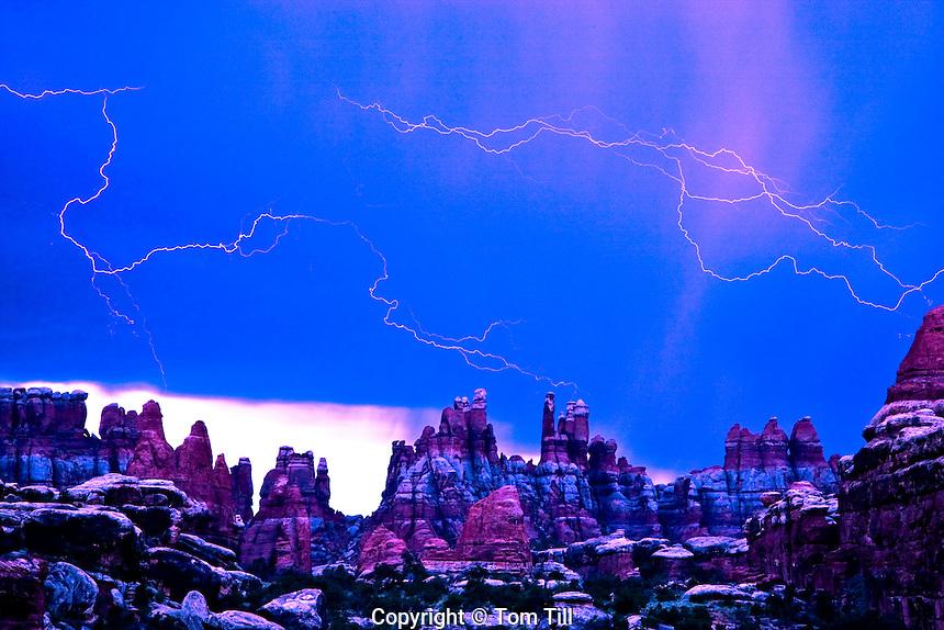 Lightning in Devils Kitchen       Canyonlands National Park, Utah  Needles District  Spring thunderstorm  Seen from Devils Pocket  Devils Pocket Trail