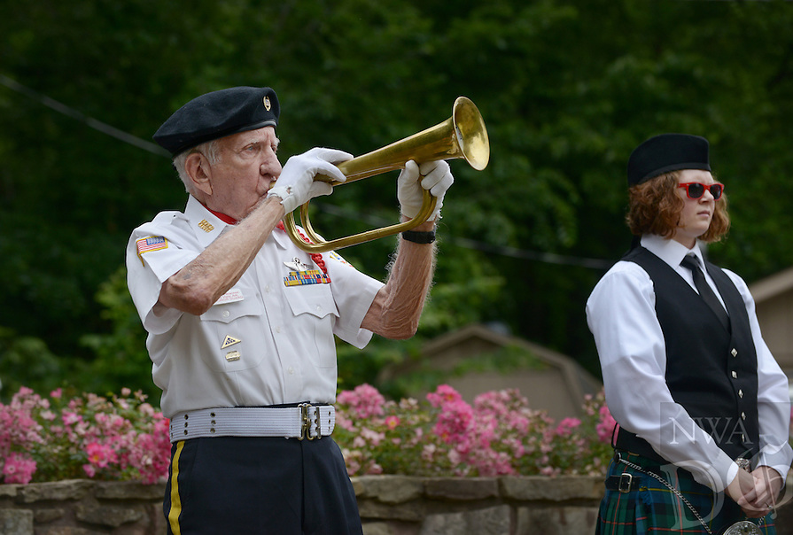 NWA Democrat-Gazette/BEN GOFF @NWABENGOFF<br /> George Brannon, bugler for the Veterans Honor Guard of Bella Vista, plays 'Taps' on Monday May 30, 2016 during the Memorial Day program presented by American Legion Post 341 at Bella Vista Memorial Garden Cemetery.