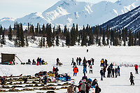 A team runs into the Rainy Pass checkpoint at Puntilla Lake in the Alaska Range during the 2019 Iditarod on Monday, March 4th 2019.<br /> <br /> Photo by Jeff Schultz/  (C) 2019  ALL RIGHTS RESERVED