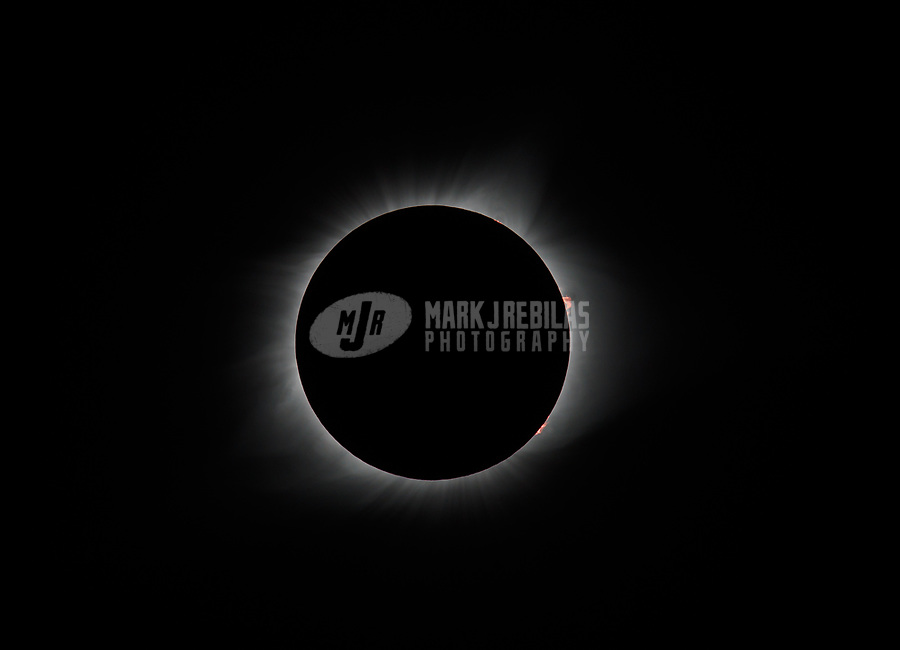 Aug 17, 2017; Sainte Genevieve, Missouri, USA;  General view of a total solar eclipse during totality as viewed from a graveyard cemetery in the town of Sainte Genevieve, Missouri. A solar eclipse is caused when the moon blocks the sun and casts a shadow on the Earth. Mandatory Credit: Mark J. Rebilas