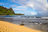A (barely) double rainbow over Makana Mountain (or Mt. Makana, also called Bali Hai), seen from Tunnels Beach, northern Kaua'i.