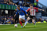 Marcus Harness of Portsmouth skips past Tom Peers of Altrincham during Portsmouth vs Altrincham, Emirates FA Cup Football at Fratton Park on 30th November 2019