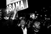 NEW YORK - NOV 04:  People react to Barack Obama's victory over John McCain for the 44th United States presidential election on November 4, 2008, in Harlem, New York City. (Photo by Landon Nordeman) .