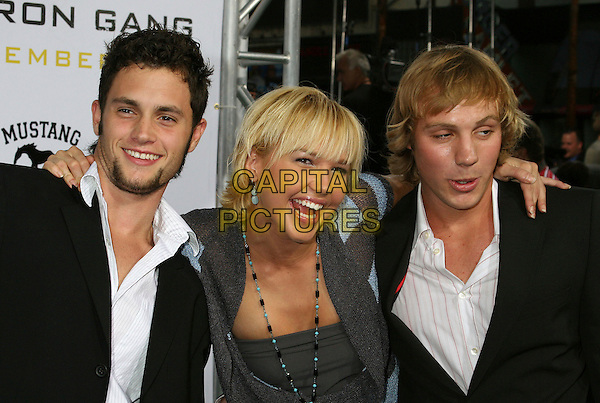 "PENN BASHLEY, ARIELLE KEBBEL & ELIOT BENJAMIN.Los Angeles Premiere of ""Gridiron Gang"" at Grauman's Chinese Theatre, Hollywood, California, USA..September 5th, 2006.Ref: ADM/BP.half length arms over shoulders.www.capitalpictures.com.sales@capitalpictures.com.©Byron Purvis/AdMedia/Capital Pictures."