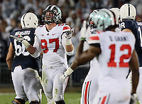 Ohio State Buckeyes defensive lineman Joey Bosa (97) celebrates a tackle in the fourth  quarter of their game at Beaver Stadium in State College, PA on October 25, 2014. (Columbus Dispatch photo by Brooke LaValley)