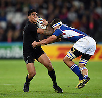 Malakai Fekitoa of New Zealand is tackled. Rugby World Cup Pool C match between New Zealand and Namibia on September 24, 2015 at The Stadium, Queen Elizabeth Olympic Park in London, England. Photo by: Patrick Khachfe / Onside Images