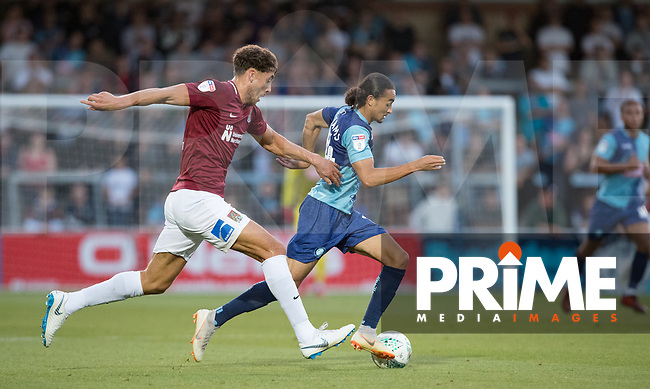 Randell Williams (on loan from Watford) of Wycombe Wanderers & Matt Crooks of Northampton Town during the Carabao Cup match between Wycombe Wanderers and Northampton Town at Adams Park, High Wycombe, England on 14 August 2018. Photo by Andy Rowland.