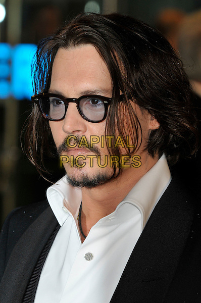 JOHNNY DEPP.Royal World Film Premiere of 'Alice in Wonderland' at the Odeon cinema, Leicester Square, London, England, UK,.25th February 2010.arrivals portrait headshot glasses moustache goatee soul patch facial hair mustache white shirt profile .CAP/PL.©Phil Loftus/Capital Pictures