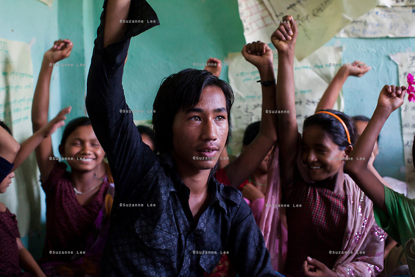 Chandraseker Shahi, 17, with other members of the Kishuri Sachetana Child Club during a meeting in their activity center in Thahuri Tole, Chhinchu, Surkhet district, Western Nepal, on 1st July 2012. These Child Clubs, supported by the government, Save the Children and their local partner NGO Safer Society, advocate for child rights and against child marriages and use peer support and education to end child marriages and raise awareness. Photo by Suzanne Lee for Save The Children UK