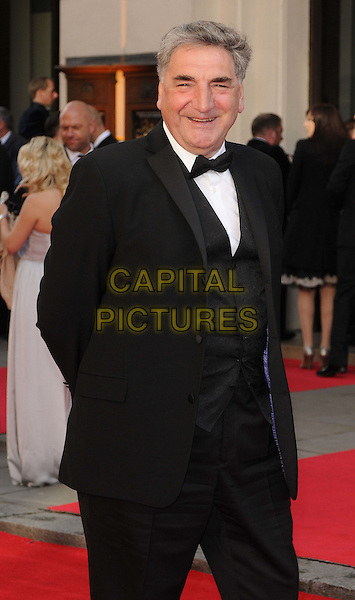 Jim Carter.The Olivier Awards 2012, Royal Opera House, Covent Garden, London, England..April 15th, 2012.half length black white bow tie tuxedo.CAP/CAN.©Can Nguyen/Capital Pictures.