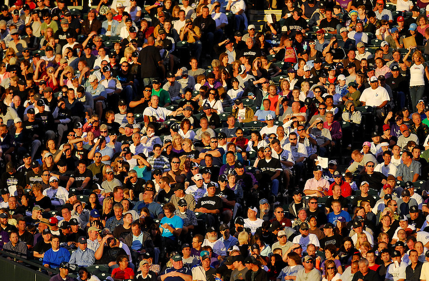 August 25, 2009: Baseball fans take in the game from the sunny right field corner of Coors Field during a regular season game between the Los Angeles Dodgers and the Colorado Rockies at Coors Field in Denver, Colorado. The Rockies beat the Dodgers 5-4 in 10 innings. *****For editorial use only*****
