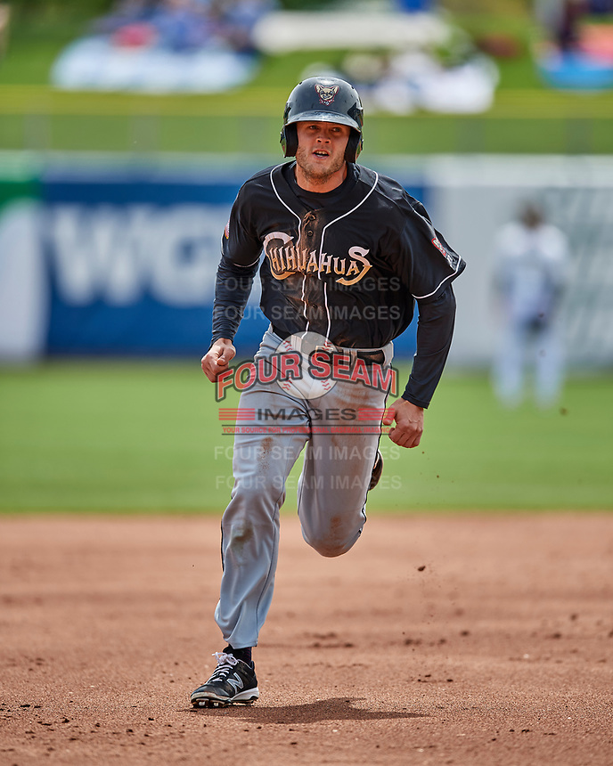 Nick Buss (11) of the El Paso Chihuahuas hustles to third base during the game against the Salt Lake Bees in Pacific Coast League action at Smith's Ballpark on April 30, 2017 in Salt Lake City, Utah.   El Paso defeated Salt Lake 3-0. This was Game 1 of a double-header. (Stephen Smith/Four Seam Images)