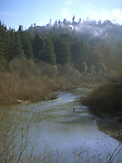 Steelhead fisherman in the Navarro River in Anderson Valley California