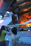 Women dance during a concert by Luna Negra in the Frank Gehry designed Pritzker Pavilion in Millennium Park in Chicago, Illinois on July 23, 2009.