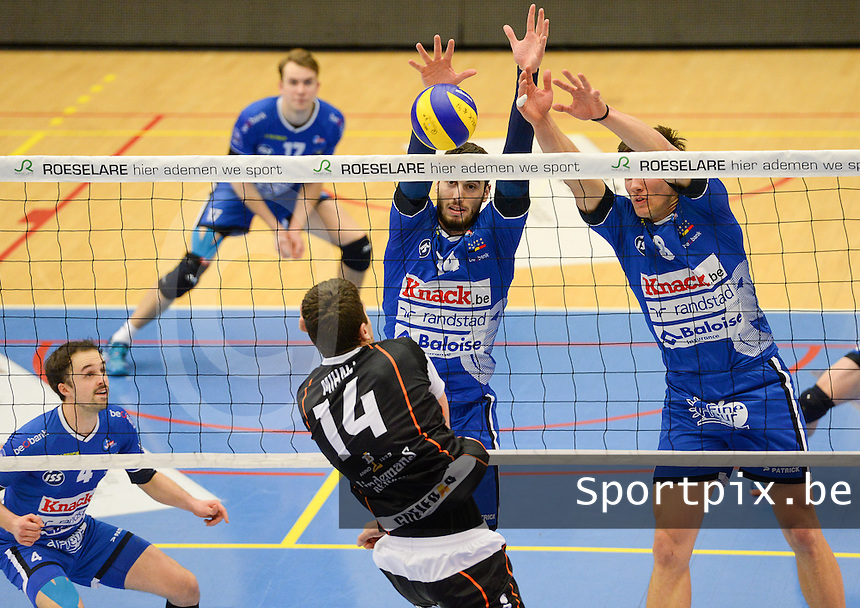 20161228 - ROESELARE ,  BELGIUM : Roeselare's Miquel Angel Fornes (middle) and Matthijs Verhanneman (right) pictured blocking the attempt of Aalst's Ivan Mihalj (14) during the second semi final in the Belgian Volley Cup between Knack Volley Roeselare and Lindemans Aalst in Roeselare , Belgium , Wednesday 28 th December 2016 . PHOTO SPORTPIX.BE | DAVID CATRY