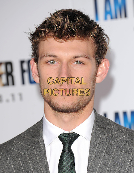 ALEX PETTYFER .attends the Dreamworks' World Premiere of 'I Am Number Four' held at The Village Theater in Westwood, California, USA, 9th February 2011..portrait headshot beard facial hair pinstripe grey gray green tie .CAP/RKE/DVS.©DVS/RockinExposures/Capital Pictures.