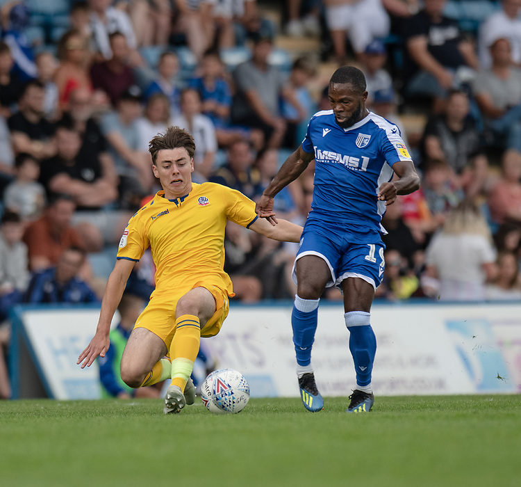 Bolton Wanderers' Callum King-Harmes (left) battles for possession with Gillingham's Mark Marshall (right) <br /> <br /> Photographer David Horton/CameraSport<br /> <br /> The EFL Sky Bet League One - Gillingham v Bolton Wanderers - Saturday 31st August 2019 - Priestfield Stadium - Gillingham<br /> <br /> World Copyright © 2019 CameraSport. All rights reserved. 43 Linden Ave. Countesthorpe. Leicester. England. LE8 5PG - Tel: +44 (0) 116 277 4147 - admin@camerasport.com - www.camerasport.com