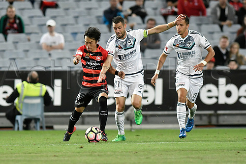 April 8th 2017, ANZ Stadium, Sydney, Australia; A-League football, Western Sydney Wanderers versus Melbourne Victory; Wanderers midfielder Jumpei Kusukami and Victory captain Carl Valeri compete for the ball; The match  ended in a 0-0 draw;