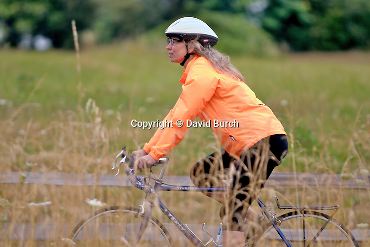 Mature woman riding bicycle in field