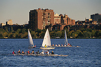 Massachusetts, Boston; Collegiate Sculling Crew On Charles River;  Back Bay & Boston Skyline In Backgroun