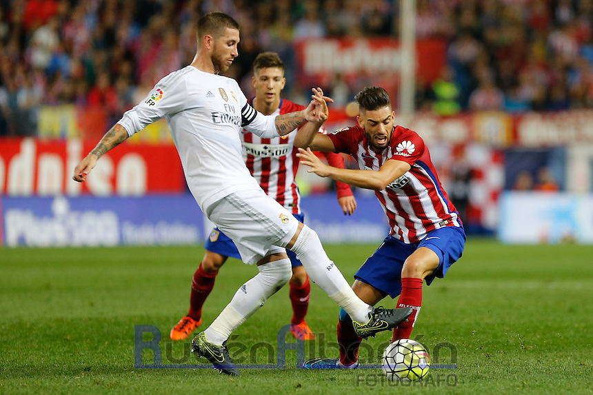 Real Madrid´s Sergio Ramos and Atletico Madrid´s Carrasco