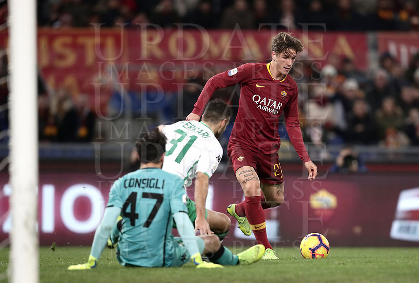 Football, Serie A: AS Roma - US Sassuolo, Olympic stadium, Rome, December 26, 2018. <br /> Roma&rsquo;s Nicol&ograve; Zaniolo (r) is going to score contrasted by Sassuolo's goalkeeper Andrea Consigli (l) and Gianmarco Ferrari (c) during the Italian Serie A football match between Roma and Sassuolo at Rome's Olympic stadium, on December 26, 2018.<br /> UPDATE IMAGES PRESS/Isabella Bonotto