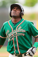 Marcell Ozuna #34 of the Greensboro Grasshoppers winces in pain after fouling a ball off himself during the game against the Hickory Crawdads at L.P. Frans Stadium on May 18, 2011 in Hickory, North Carolina.   Photo by Brian Westerholt / Four Seam Images