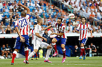 Benzema of Real Madrid and Juanfran of Atletico de Madrid during La Liga match between Real Madrid and Atletico de Madrid at Santiago Bernabeu stadium in Madrid, Spain. September 13, 2014. (ALTERPHOTOS/Caro Marin)