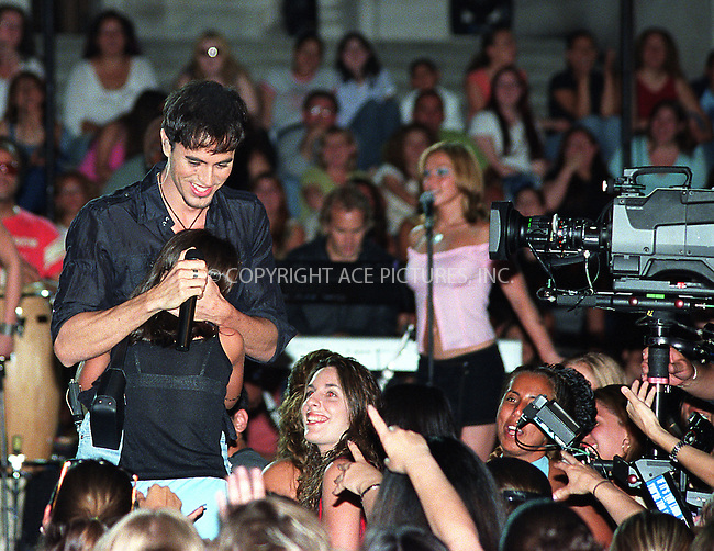 """Spanish crooner ENRIQUE IGLESIAS giving a concert on the steps of New York Public Library, which will be televised during NBC's 4th of July special, """"Macy's 4th of July Fireworks Spectacular 2002."""" New York, June 28, 2002.  Please byline: Alecsey Boldeskul/NY Photo Press.   ..*PAY-PER-USE*      ....NY Photo Press:  ..phone (646) 267-6913;   ..e-mail: info@nyphotopress.com"""
