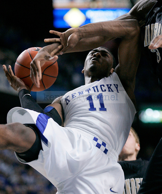 Freshman guard John Wall is fouled by a Vanderbilt defender during the second half of the game at Rupp Arena on Saturday. Photo by Zach Brake | Staff.