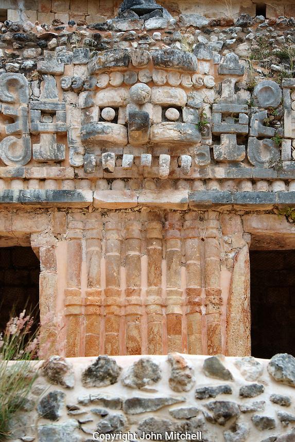 Giant Chaac mask on facade of the Palace or El Palacio at the Mayan ruins of Sayil, Yucatan, Mexico