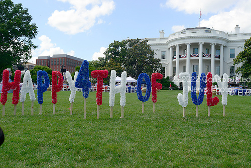 The South Lawn of the White House is prepared for a barbeque hosted by United States President Barack Obama and first lady Michelle Obama for military heroes and their families in commemoration of Independence Day, Thursday, July 4, 2013.<br /> Credit: Ron Sachs / Pool via CNP