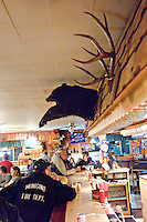 Bar scene from the Bear Trap Inn in Van Meer Michigan showing whitetail deer antlers and black bear shoulder mount.