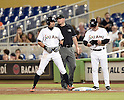 Ichiro Suzuki (Marlins), MAY 18, 2015 - MLB : Miami Marlins batter Ichiro Suzuki (L) on the first base after hitting his 2,873rd major league hit in the fifth inning during the major league baseball game against the Arizona Diamondbacks at Marlins Park in Miami, United States. (Photo by AFLO)