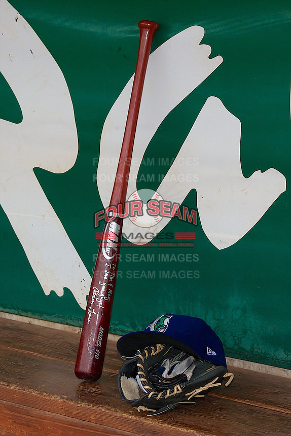 A bat, hat, and glove sit in the dugout prior to the game as the Ogden Raptors faced the Grand Junction Rockies at Lindquist Field on September 8, 2013 in Ogden Utah.  (Stephen Smith/Four Seam Images)