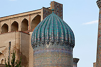 "Detail of dome, Sher-Dor Madrasah, 1619-36, Registan, Samarkand, Uzbekistan, pictured on July 16, 2010, at dawn. The Sher-Dor Madrasah, commissioned by Yalangtush Bakhodur as part of the Registan ensemble, and designed by Abdujabor, takes its name, ""Having Tigers"", from the double mosaic (restored in the 20th century) on the tympans of the portal arch showing suns and tigers attacking deer. Samarkand, a city on the Silk Road, founded as Afrosiab in the 7th century BC, is a meeting point for the world's cultures. Its most important development was in the Timurid period, 14th to 15th centuries. Picture by Manuel Cohen."