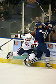 March 13, 2009:  Judd Blackwater (28) of the Rochester Amerks checks Josh Engel (9) of the Toronto Marlies in the first period during a game at the Blue Cross Arena in Rochester, NY.  Toronto defeated Rochester 4-2.  Photo copyright Mike Janes Photography 2009