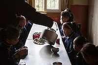 Blind and visually impaired Tibetan girl students wait for breakfast at the canteen of the School for the Blind in Tibet, in the capital city of Lhasa, September 2016.