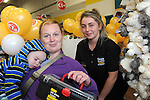 FREE PIC - NO REPRO FEE<br /> 24/09/2015 - Blackpool, Cork<br /> NAP TIME - It's all a bit too much for little Anthony Scanlon from Dublin Hill, Blackpool as he takes a nap while mum Anna purchases a toolbox for him with the help of store assistant Rachel O'Donovan at the offiicial opening of the new Dealz store at Blackpool Retail Park, Cork.<br /> Pic: Brian Lougheed
