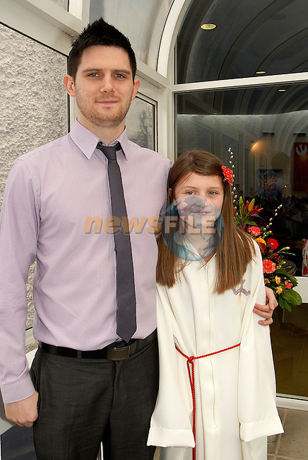 Alex Farrell with her big brother Dean at the Confirmation in Laytown. Photo:www.newsfile.ie www.newsfile.ie