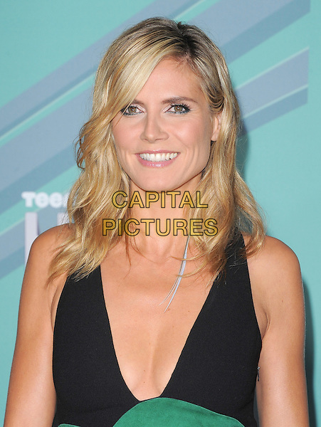 Heidi Klum .The 2011 TeenNick Halo Awards held at The Hollywood Palladium in Hollywood, California, USA..October 26th, 2011   .headshot portrait black green low cut neckline cleavage.CAP/RKE/DVS.©DVS/RockinExposures/Capital Pictures.