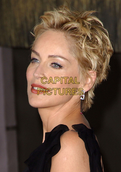 SHARON STONE  .Cold Creek Manor L.A premiere.portrait, headshot, make-up, false eyelashes, diamond earrings, short spiky hair.www.capitalpictures.com.sales@capitalpictures.com.© Capital Pictures